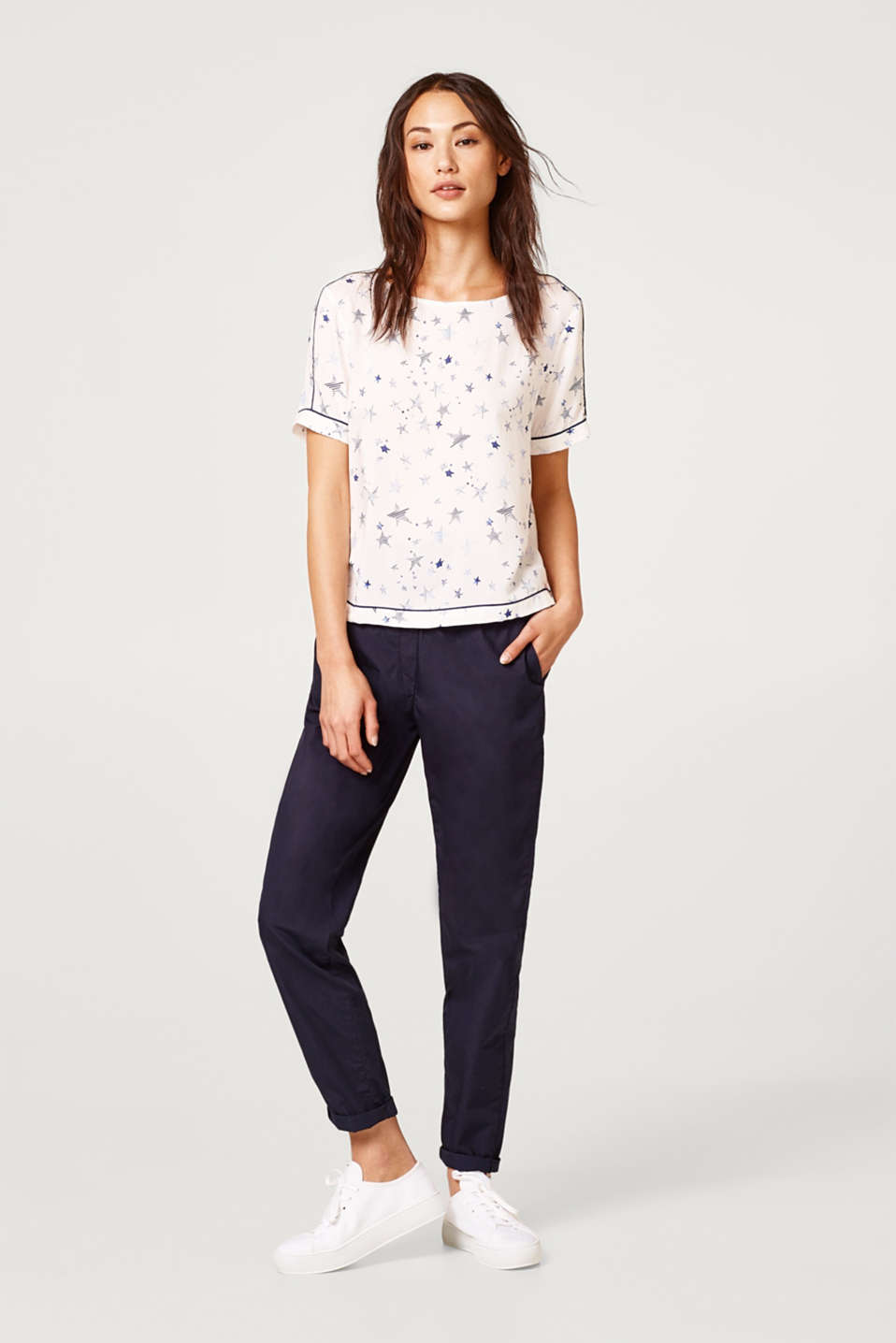 Piped blouse top with an all-over print