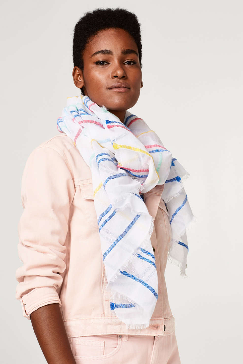 Woven scarf with a mix of textures and bright stripes