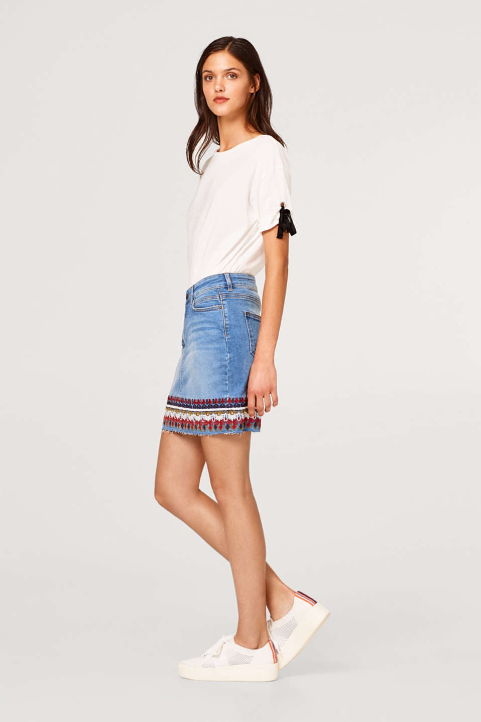 Stretch denim skirt with tribal embroidery