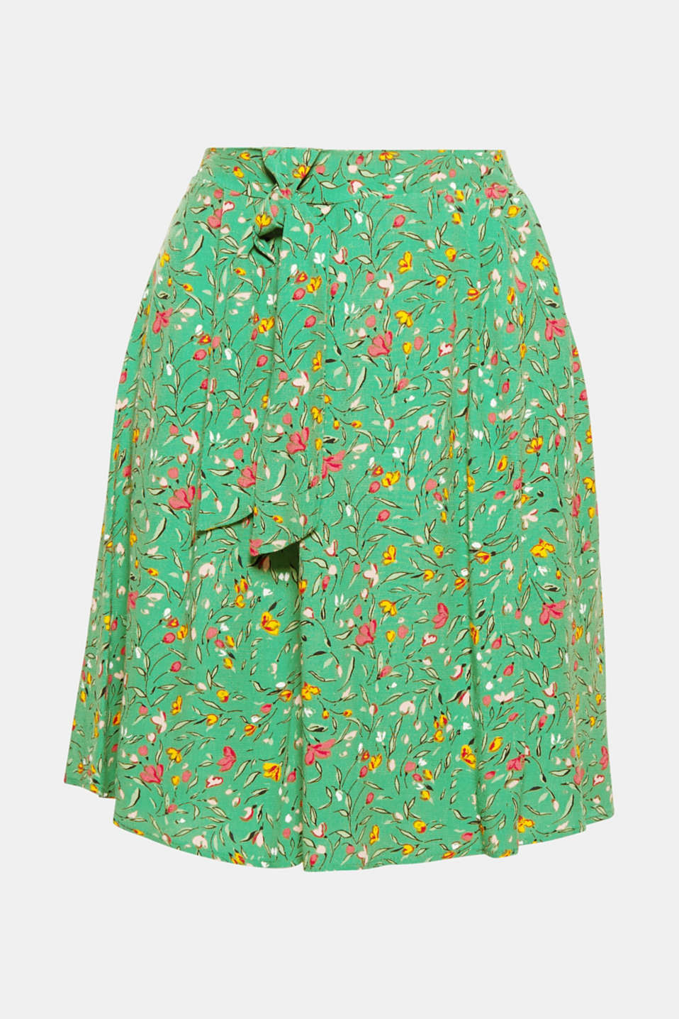 The perfect summer skirt: lightweight and fluid, swirling and flared, with a colourful floral print and bow detail at the front on the partially elasticated waistband!