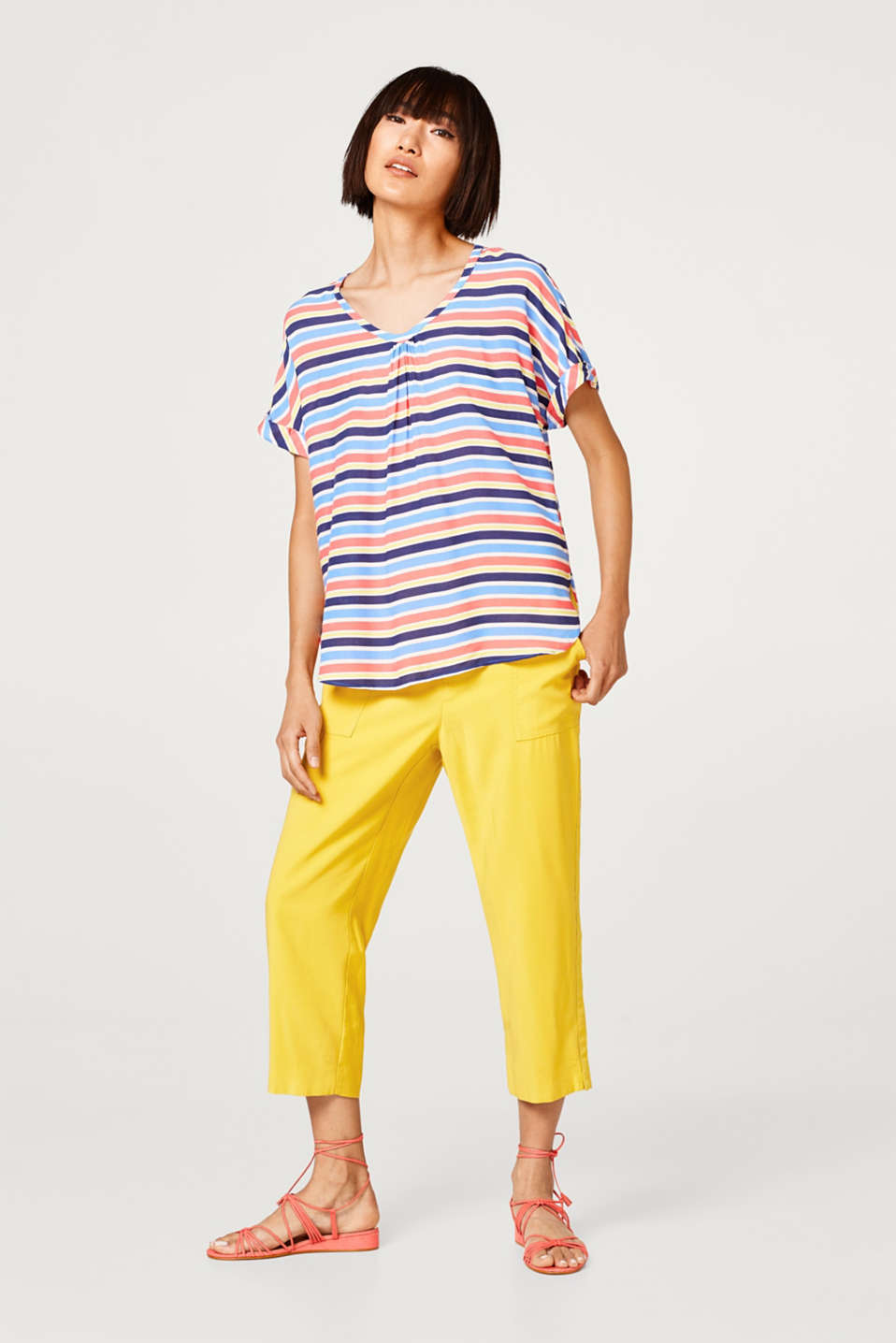 Blouse top with a colourful striped pattern