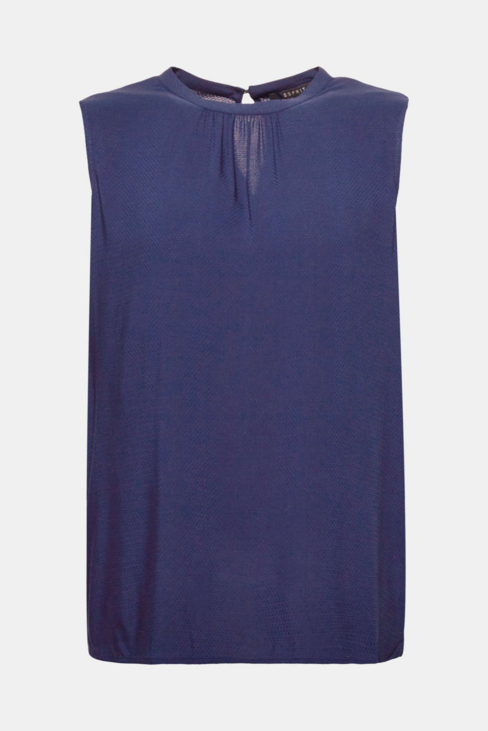 Flowing, delicate, feminine! This sleeveless blouse top is defined by its soft texture and subtly pleated round neckline.