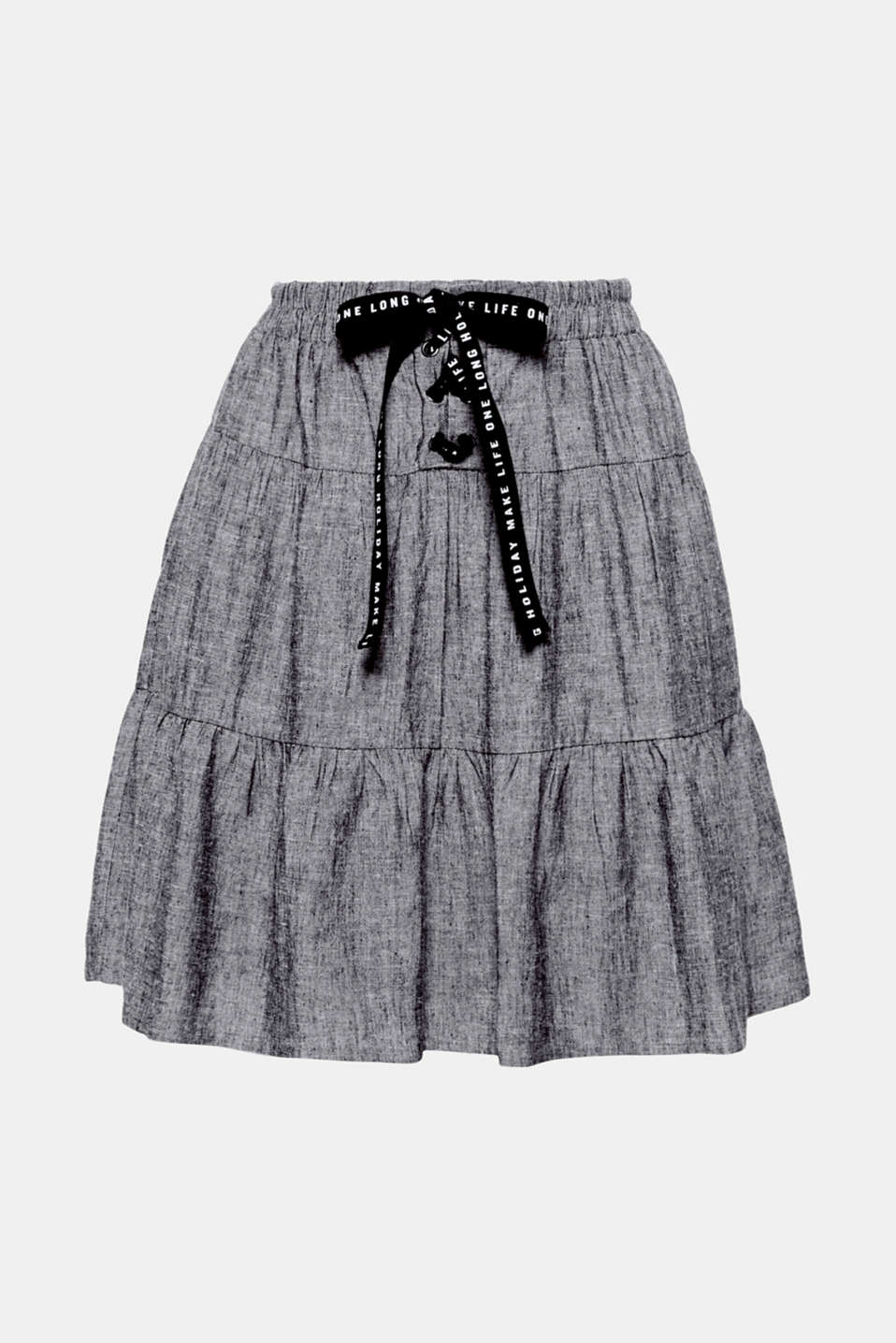 This short tiered skirt with cool linen and decorative lacing on the front of the waistband is the ultimate piece for hot days!