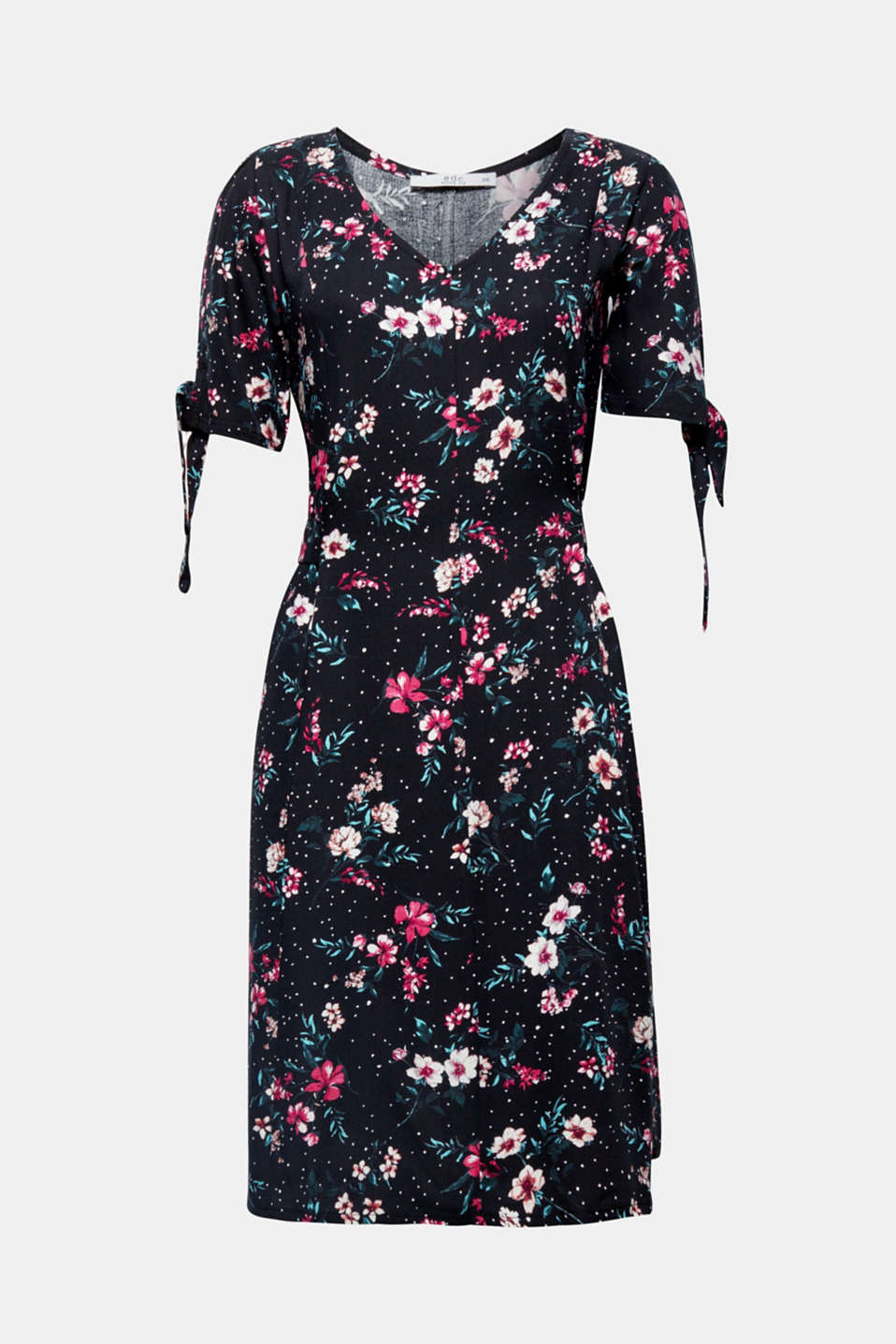 This flowing dress featuring a pretty floral print, bows on the sleeves, a fixed tie-around belt and swirling skirt is simply perfect for an on-trend, feminine look!