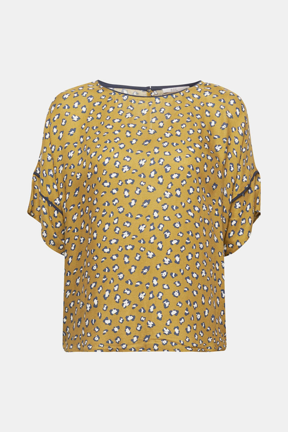 Abstract flowers or stylised animal print? Either way, the design of this flowing blouse is captivating!