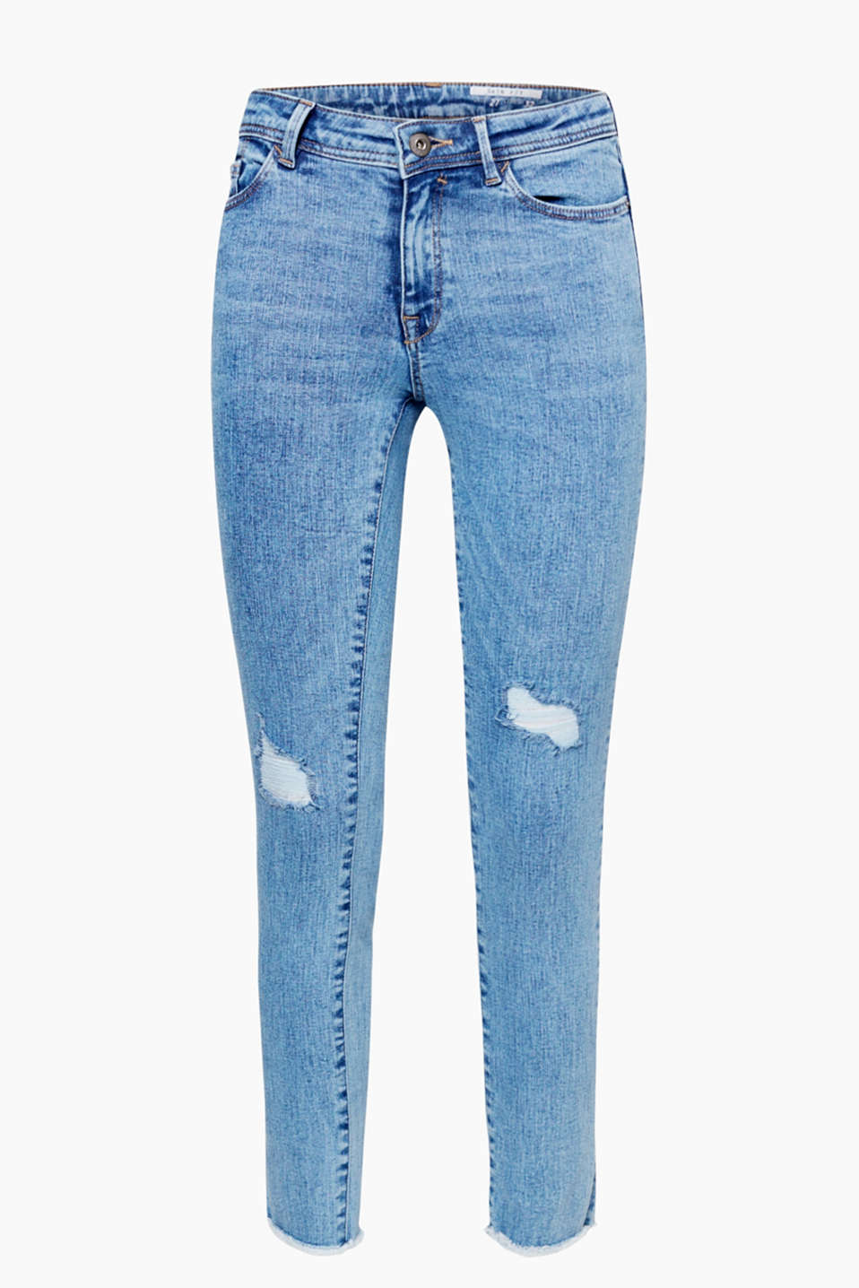 Retro rock chick vibe guaranteed: cropped, acid wash jeans with a distressed, vintage finish