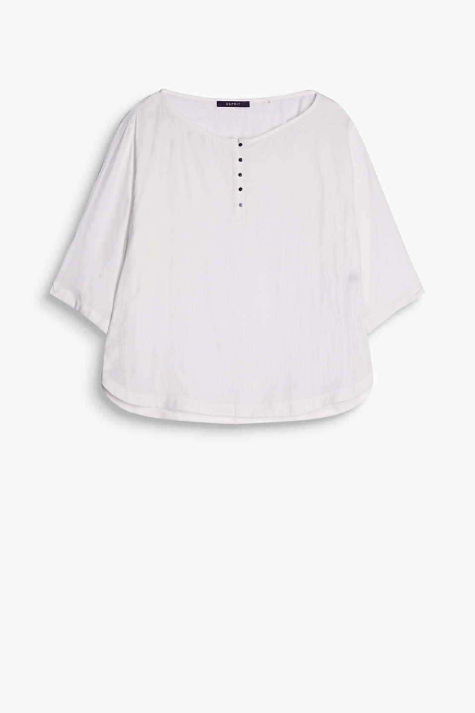 Masculine stripes meet a feminine silhouette: silky blouse with a button placket and batwing sleeves