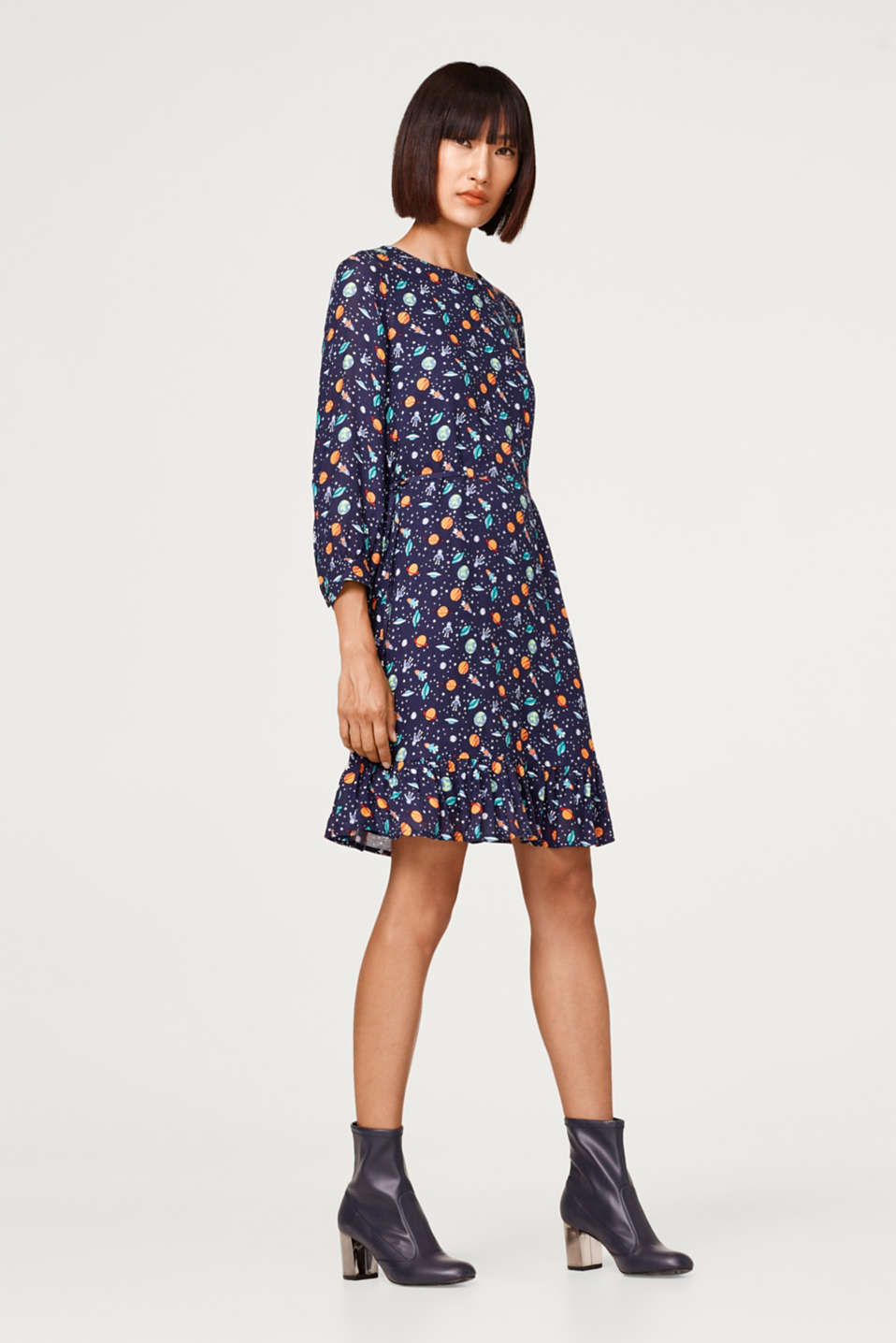Printed dress with waist ties and a flounce hem