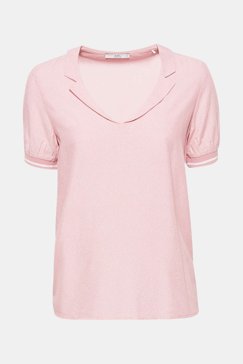 This loose and airy blouse top is the perfect blend of sporty and feminine and features a print and striped edges.