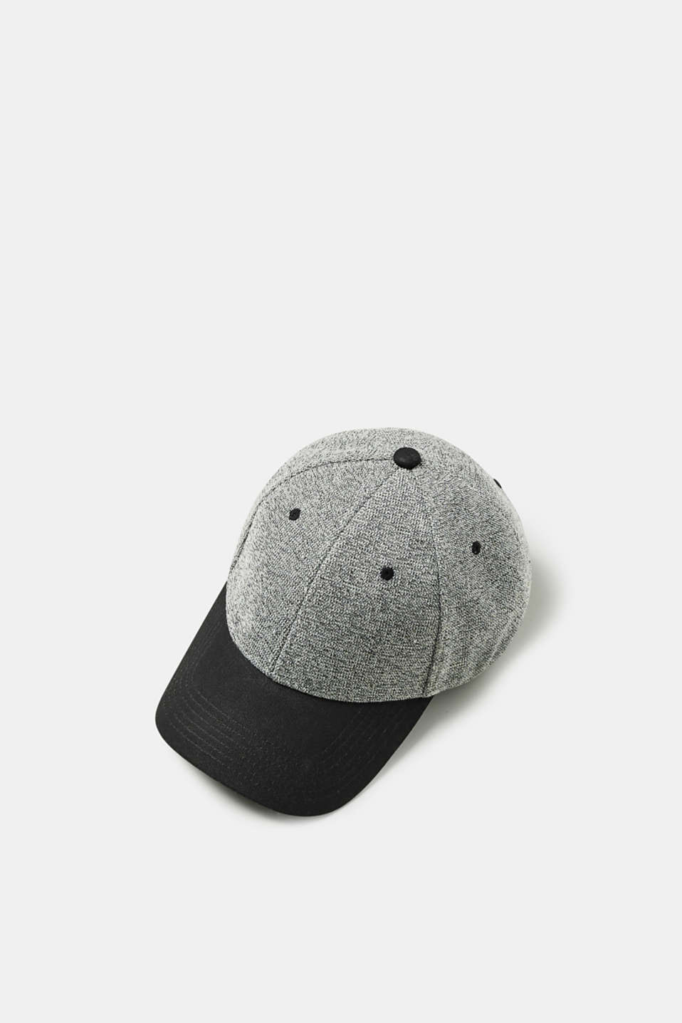 The combination of mottled and twill textured materials gives this cap its unique look.
