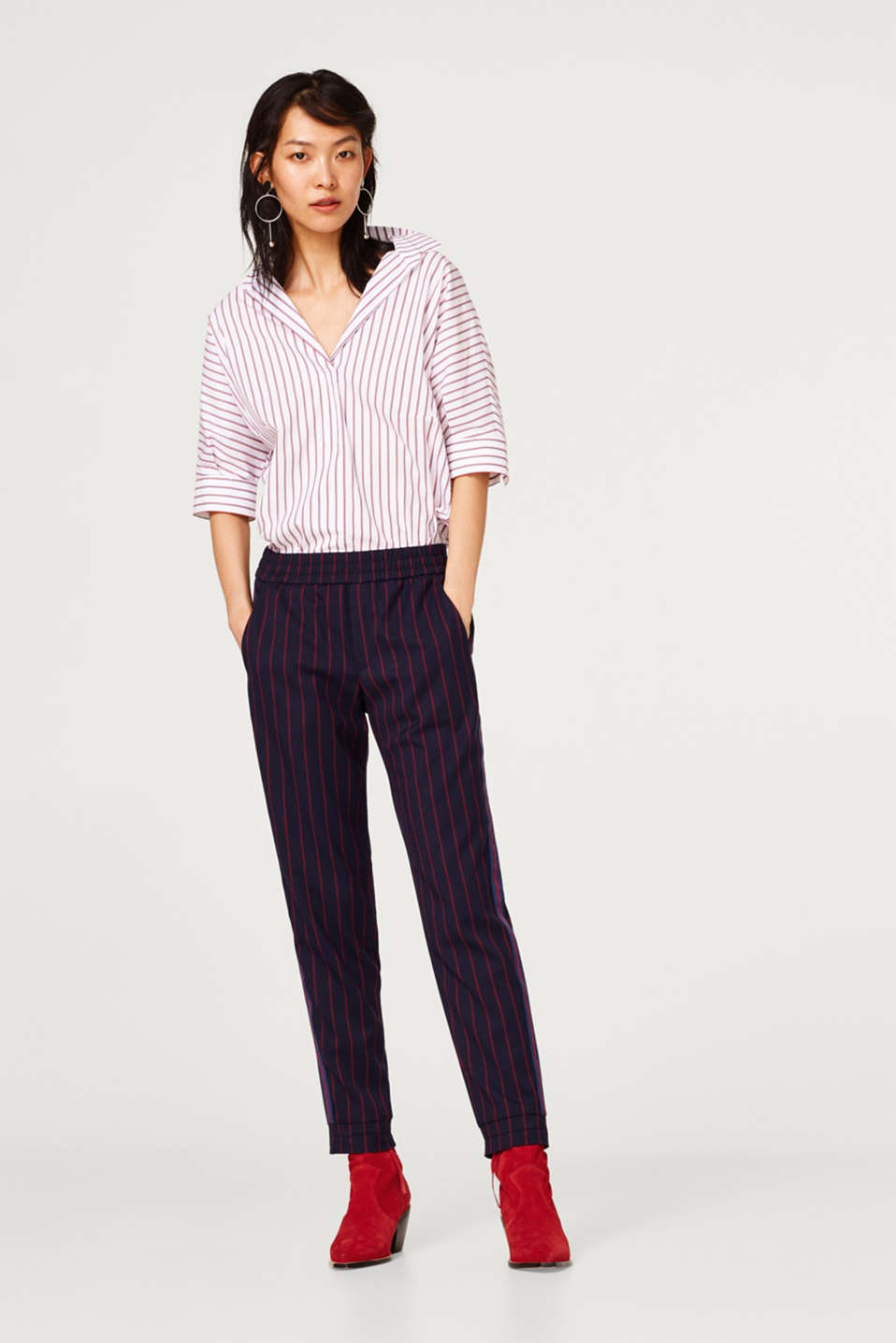 Stretch trousers in a tracksuit bottoms style with stripes