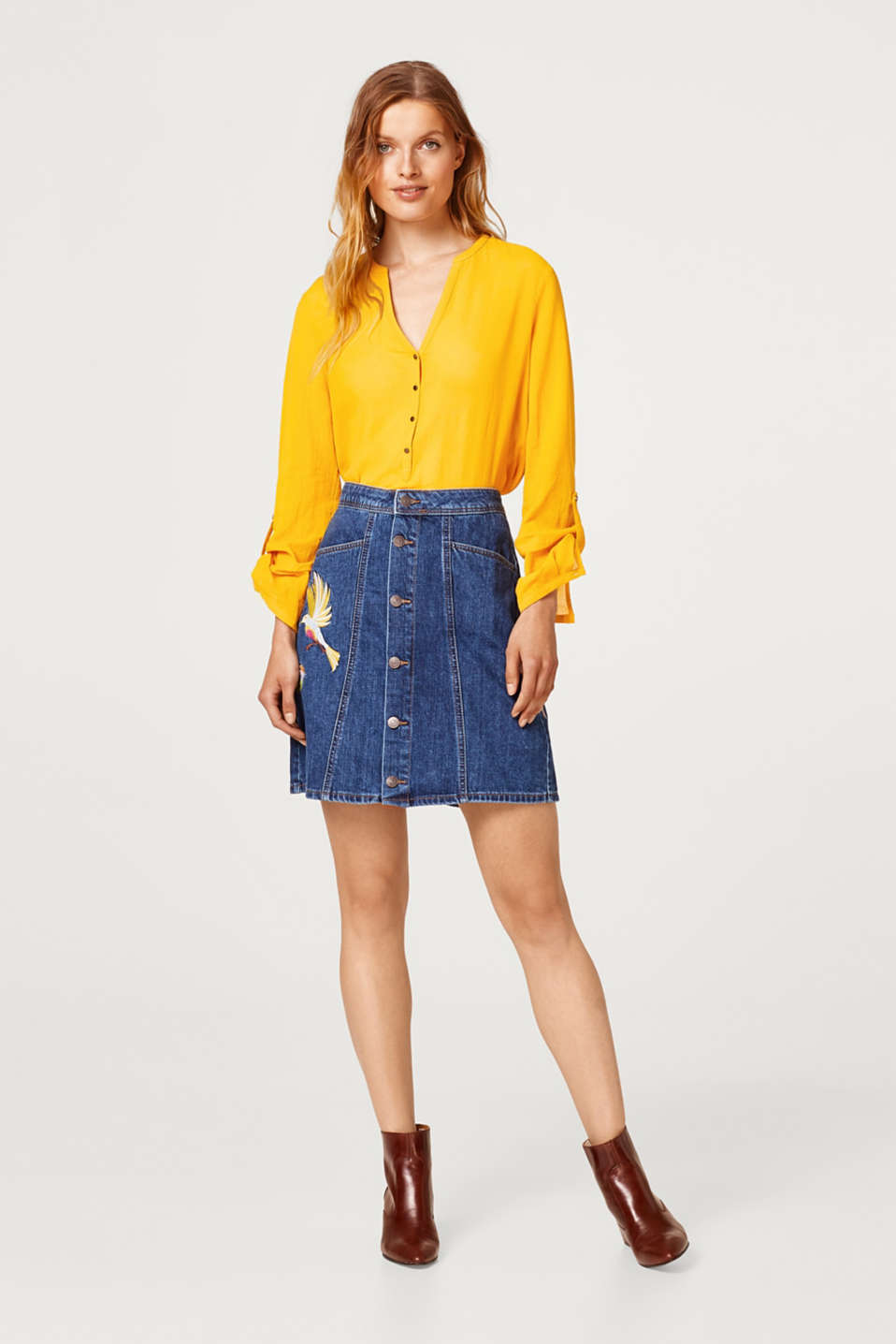 Embroidered denim skirt with a button placket
