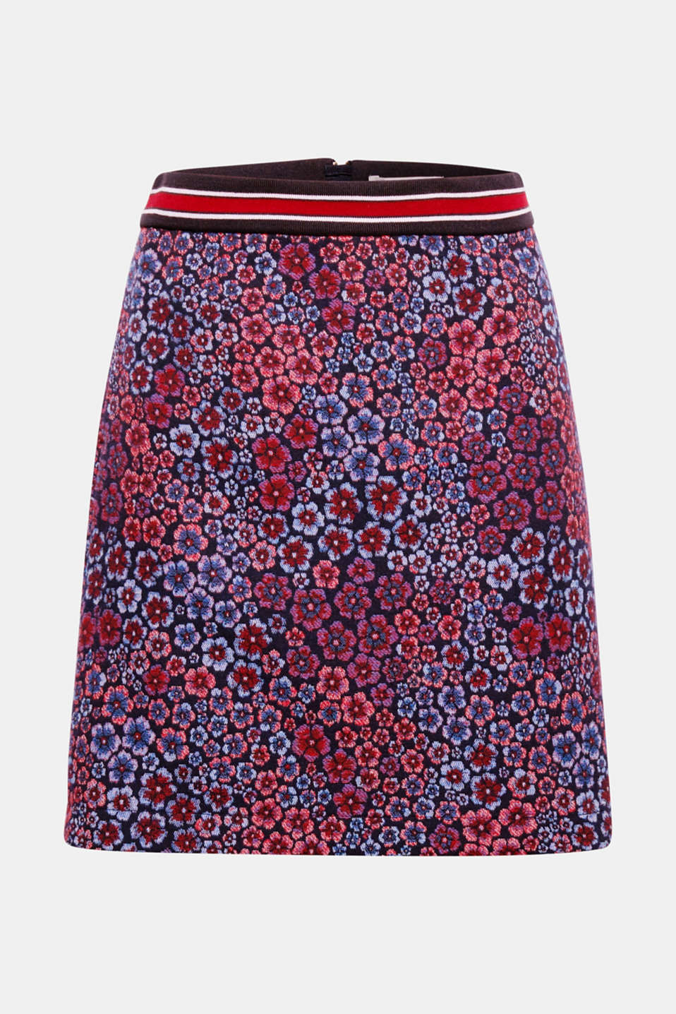 The striped, ribbed waistband combined with a decorative jacquard floral pattern give this short skirt its fashionable look.