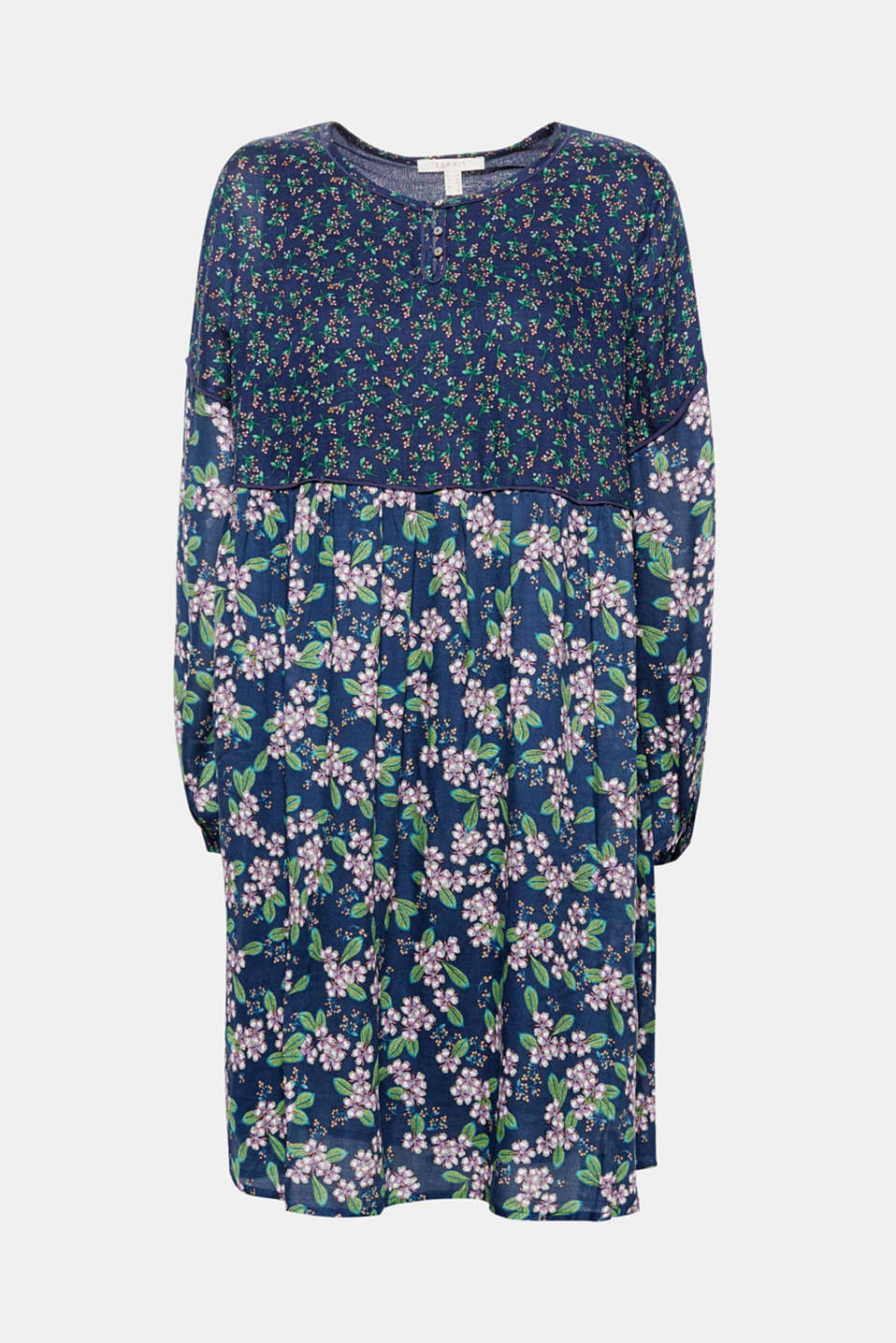 This tent dress in flowing fabric with various floral prints is lightweight and swirling!