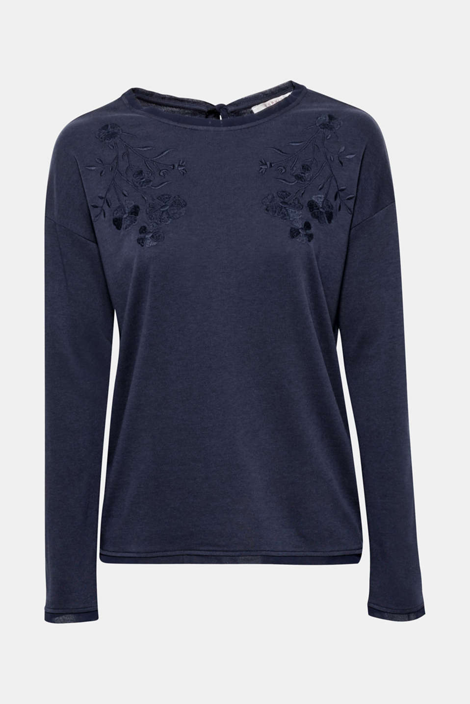 A casual fit with pretty details: The tonal embroidered underneath the neckline and dainty chiffon trims on the neckline, sleeves and hem give this long sleeve top its feminine flair!