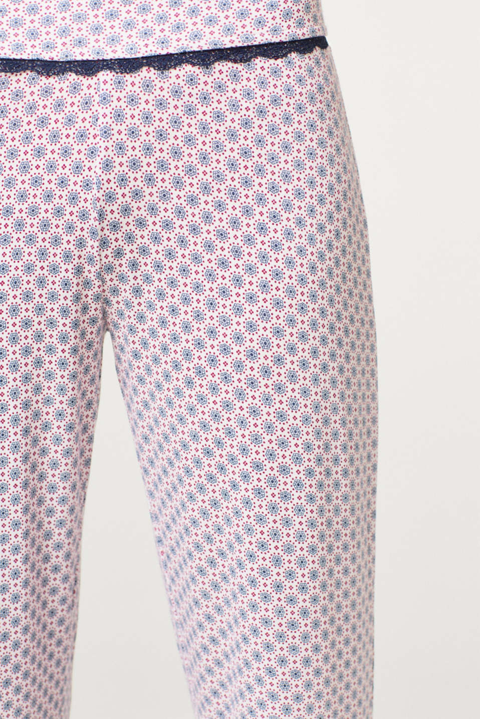 Stretch jersey trousers with an ornament print