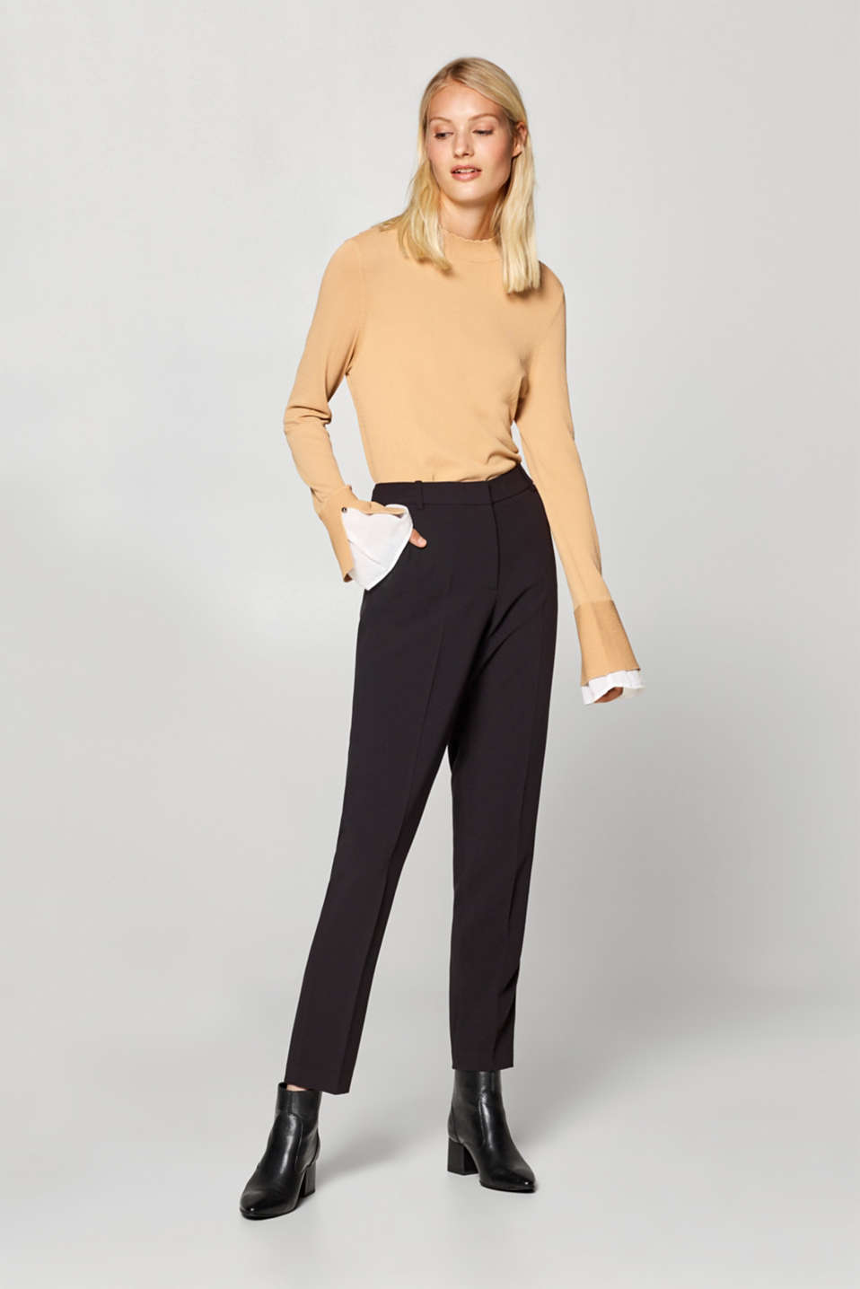 Two-way stretch trousers with pressed pleats