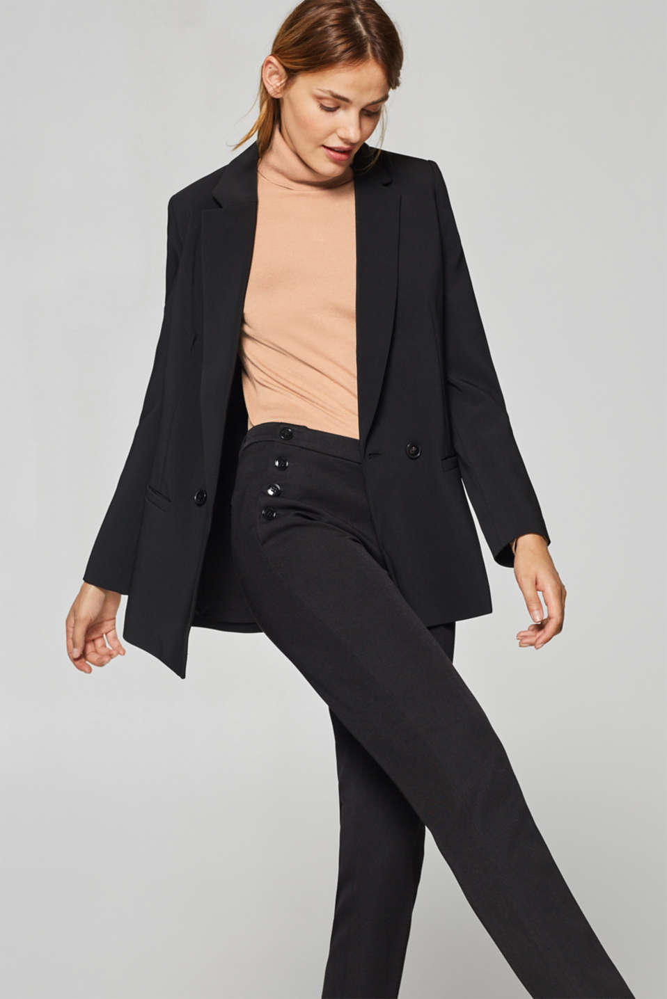 Two-way stretch trousers with button plackets