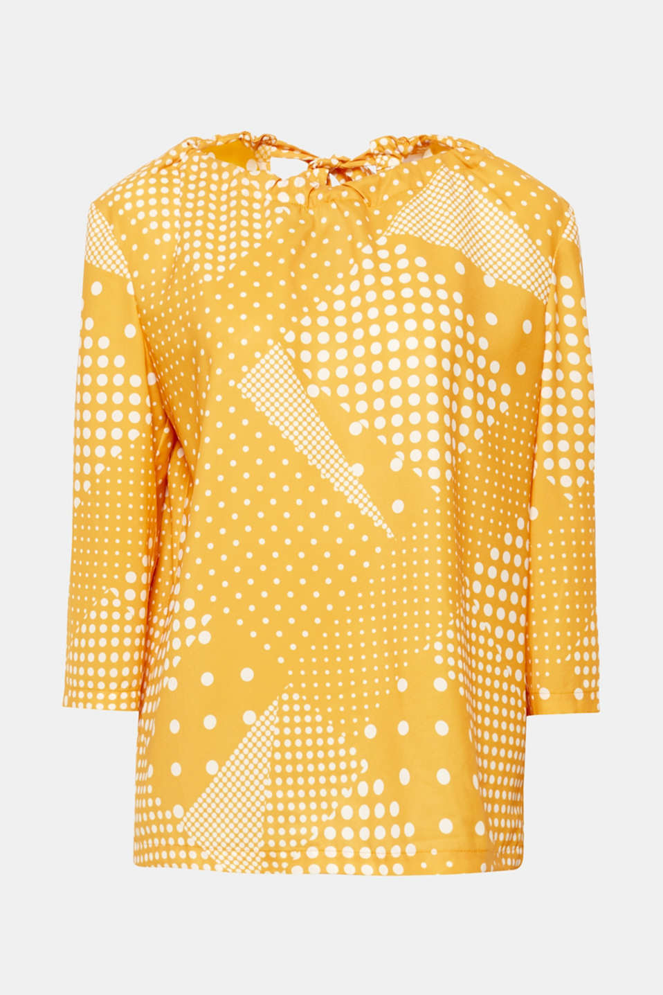 Wonderful polka dots in different sizes give this flowing, loosely cut blouse with a bow at the back its new style!
