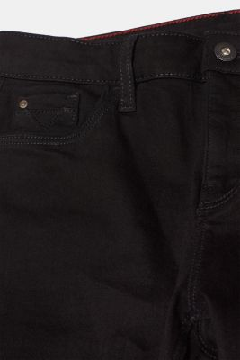 Stretch jeans with unfinished leg openings