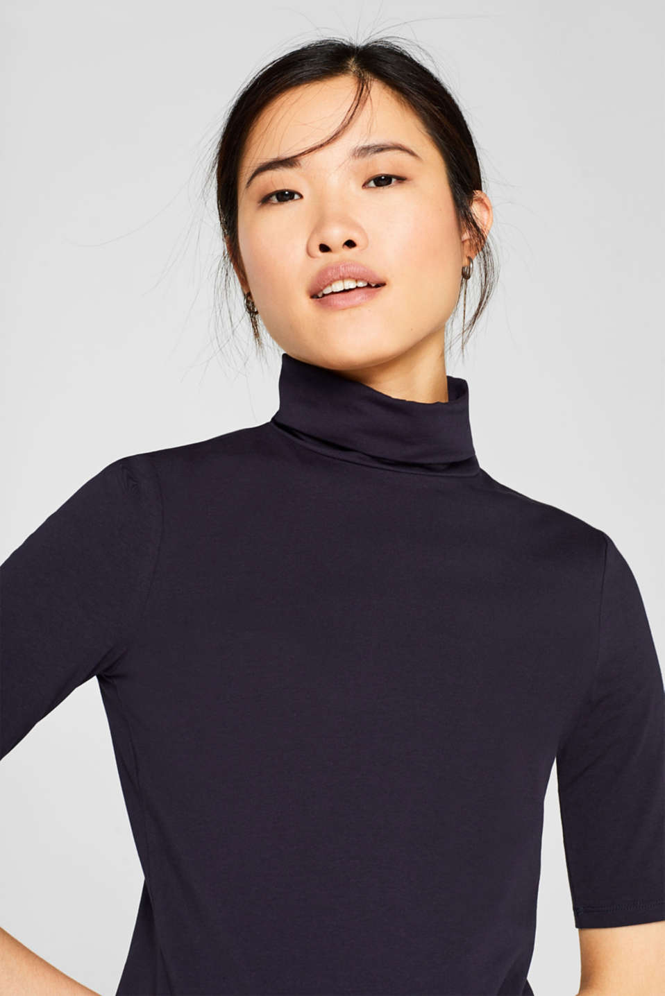 Stretch top with a polo neck