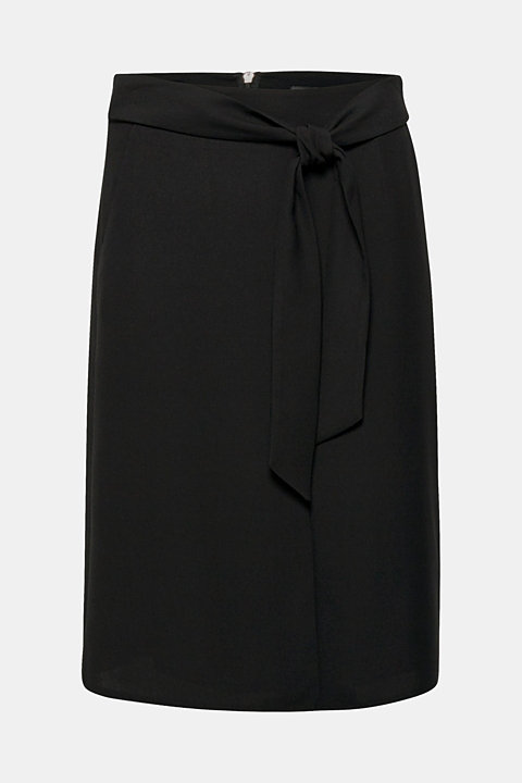 Flared skirt with a slit and tie-around belt