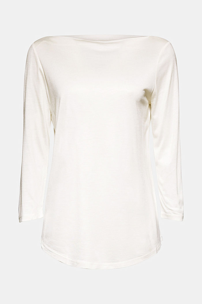 Softly shimmering long sleeve top with a bateau neckline