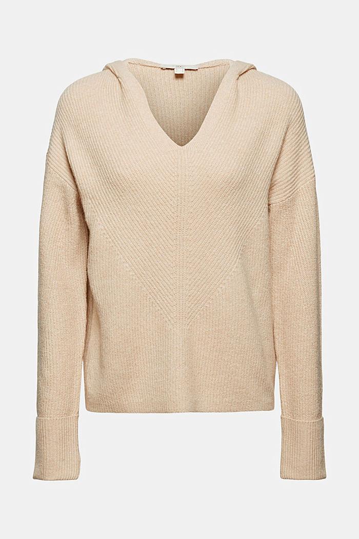 À teneur en laine: le sweat à capuche en maille côtelée