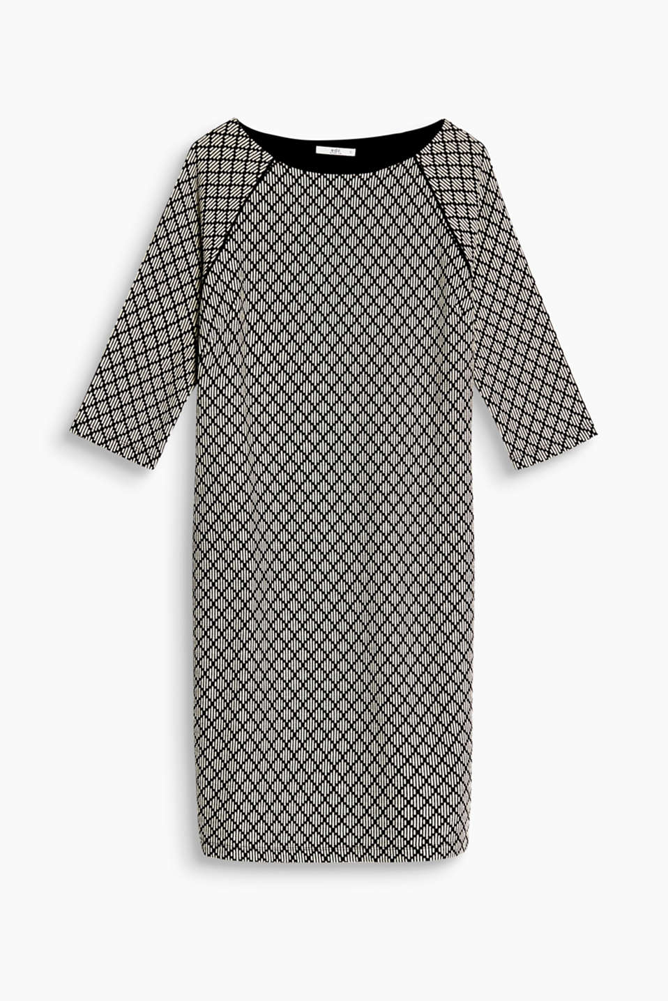 We love black and white! This dress boasts a minimalist pattern that is very striking!
