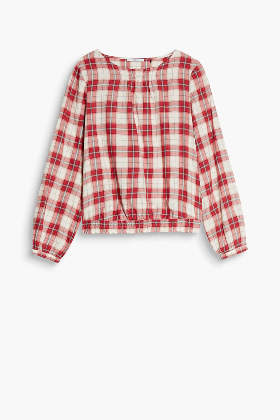 This fine blouse in cotton with elasticated, smoked hem borders features classic checks yet has a special twist.