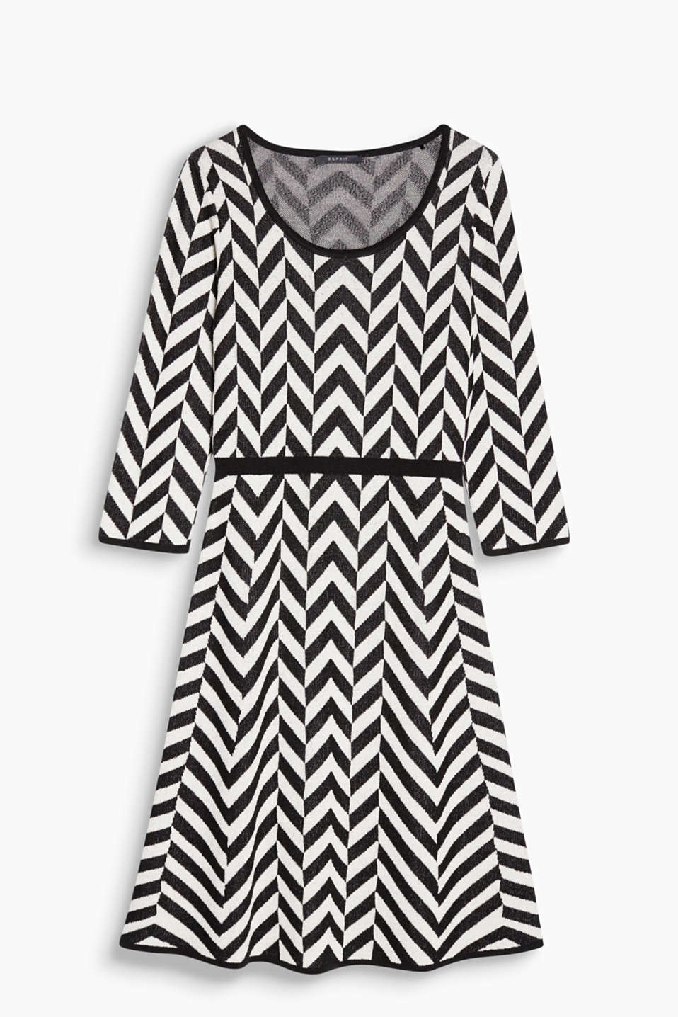 Geometric patterns can look so feminine: knitted dress with a flared skirt and zigzag pattern