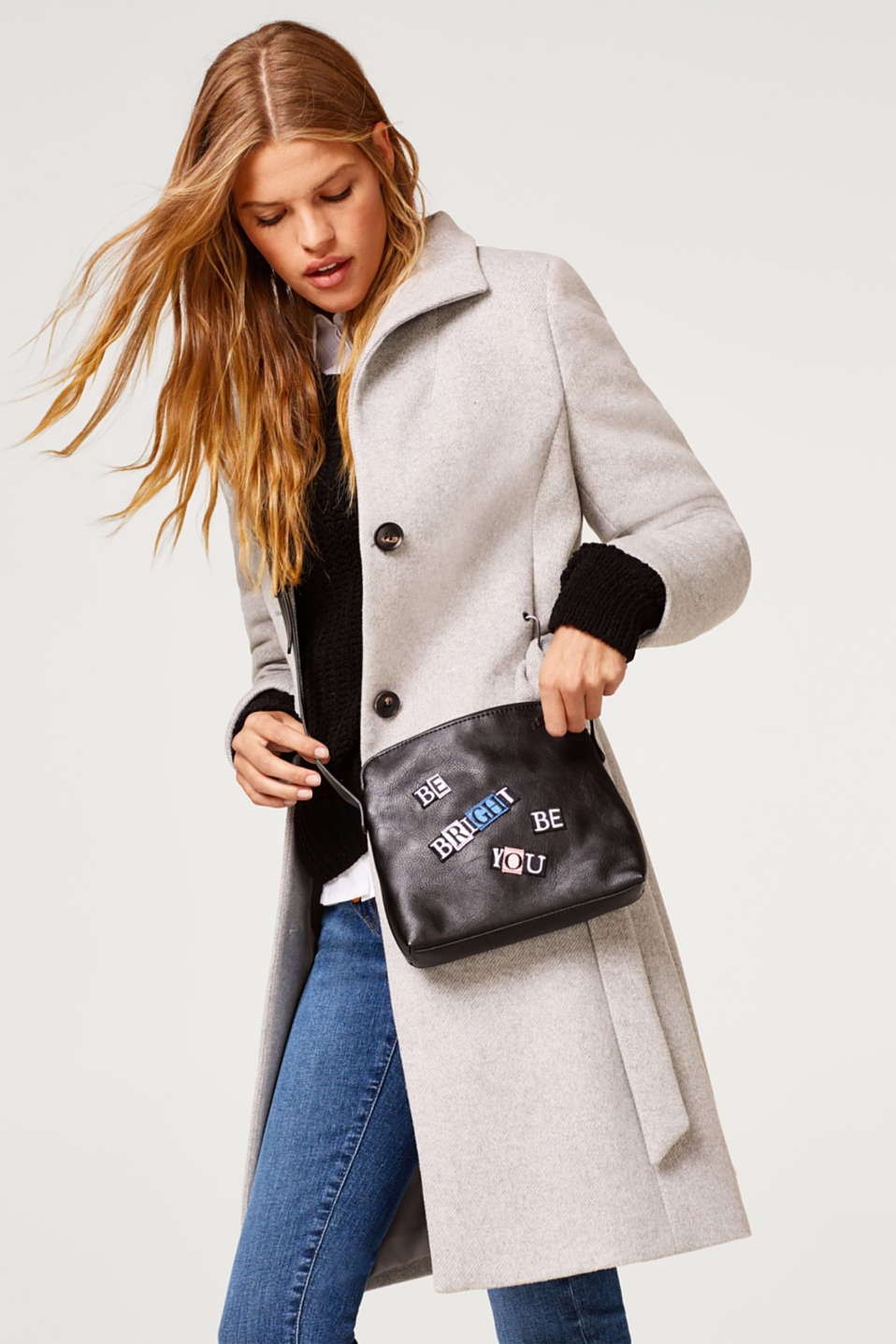 Shoulder bag with a statement, in faux leather