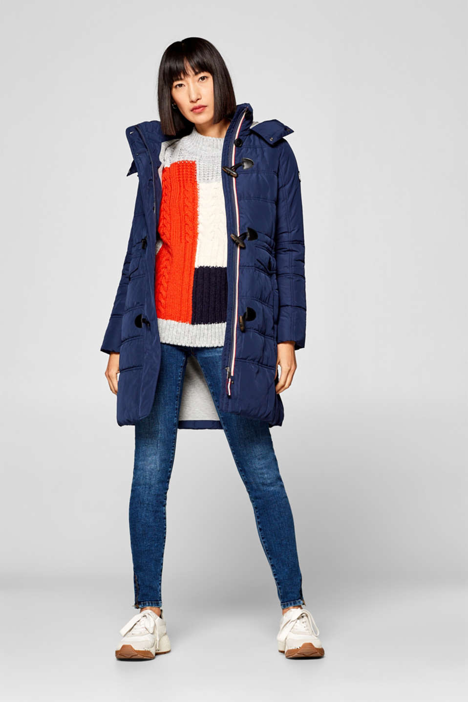 Quilted coat with an adjustable hood