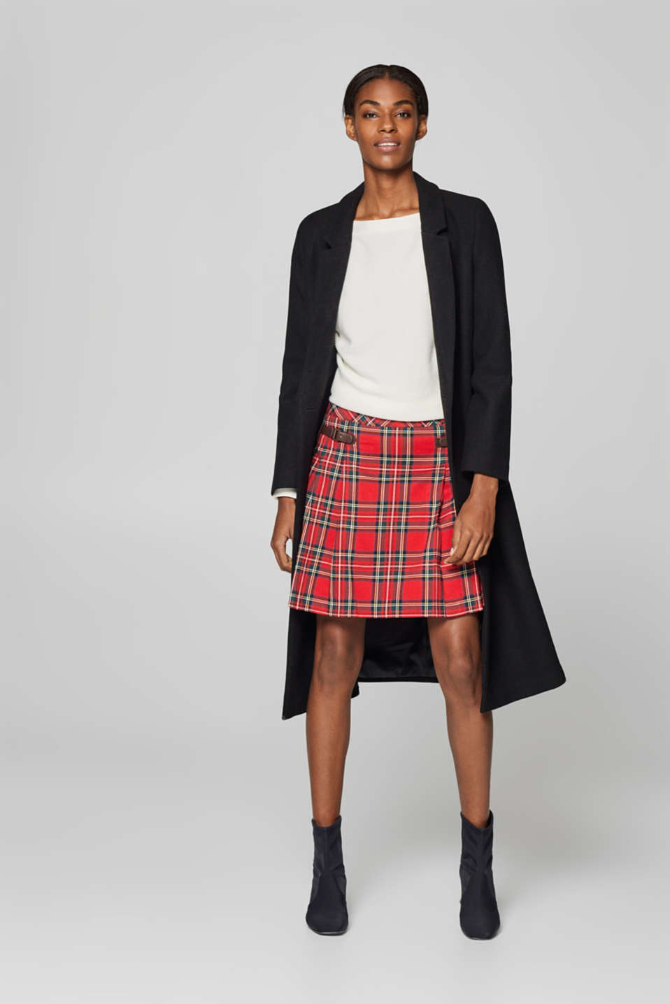 Pleated skirt with checks and decorative straps