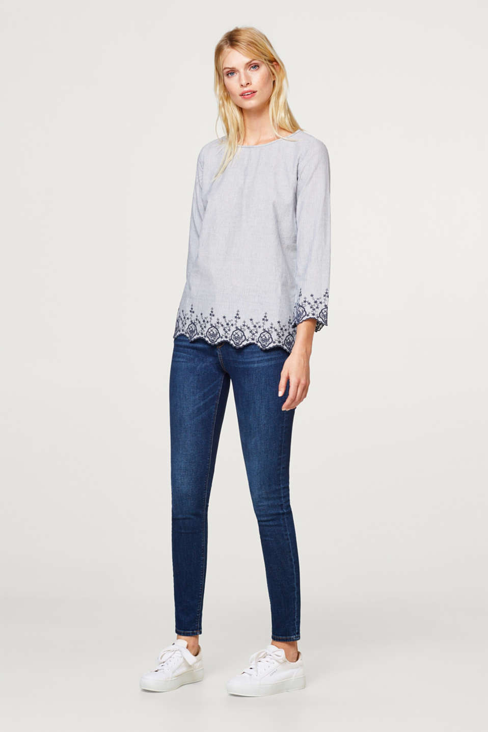Striped blouse with a scalloped hem and embroidery