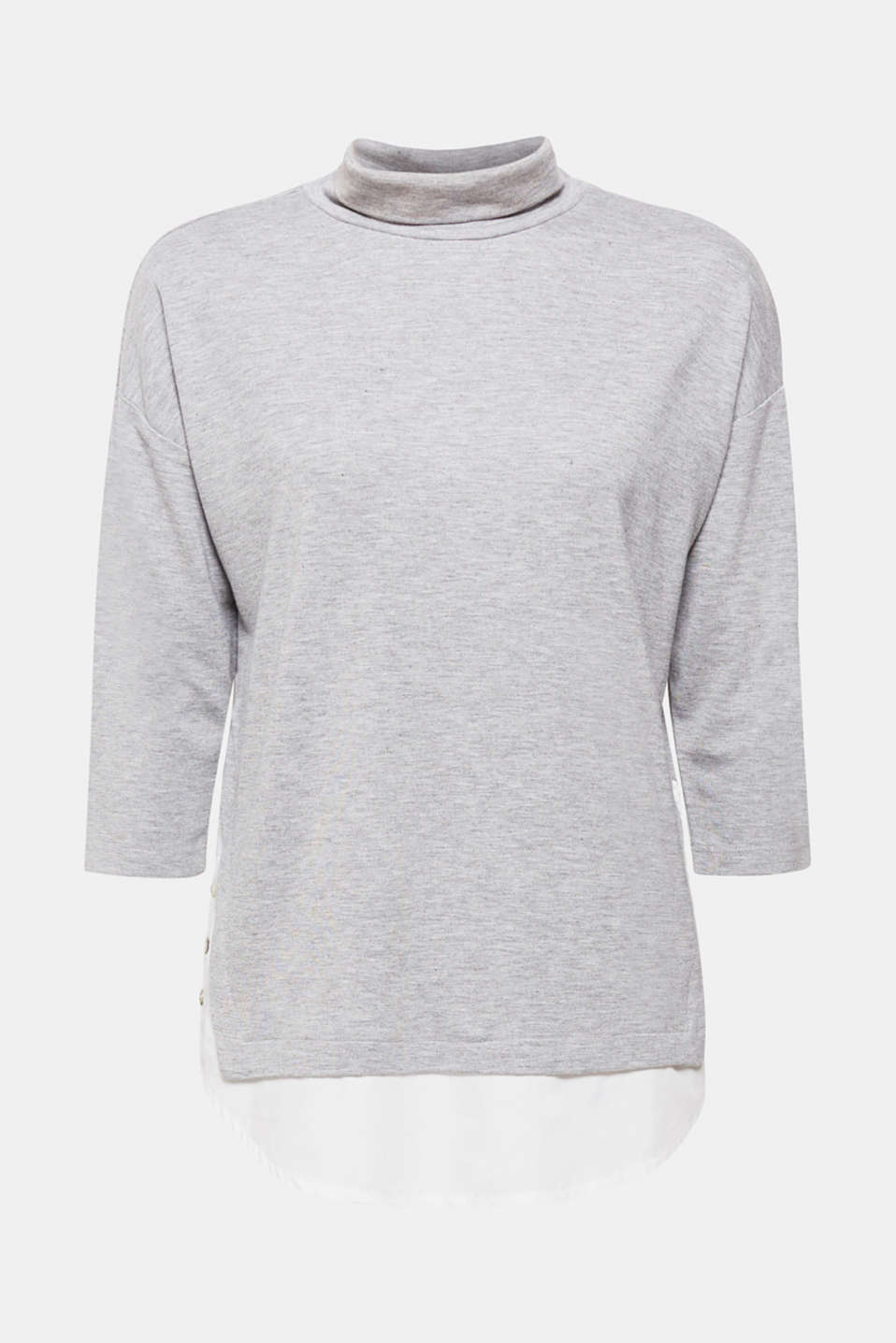 Soft jersey, a comfortable cut, a loose turtleneck collar and layered hem make this top in soft melange jersey with stretch unbeatably casual!