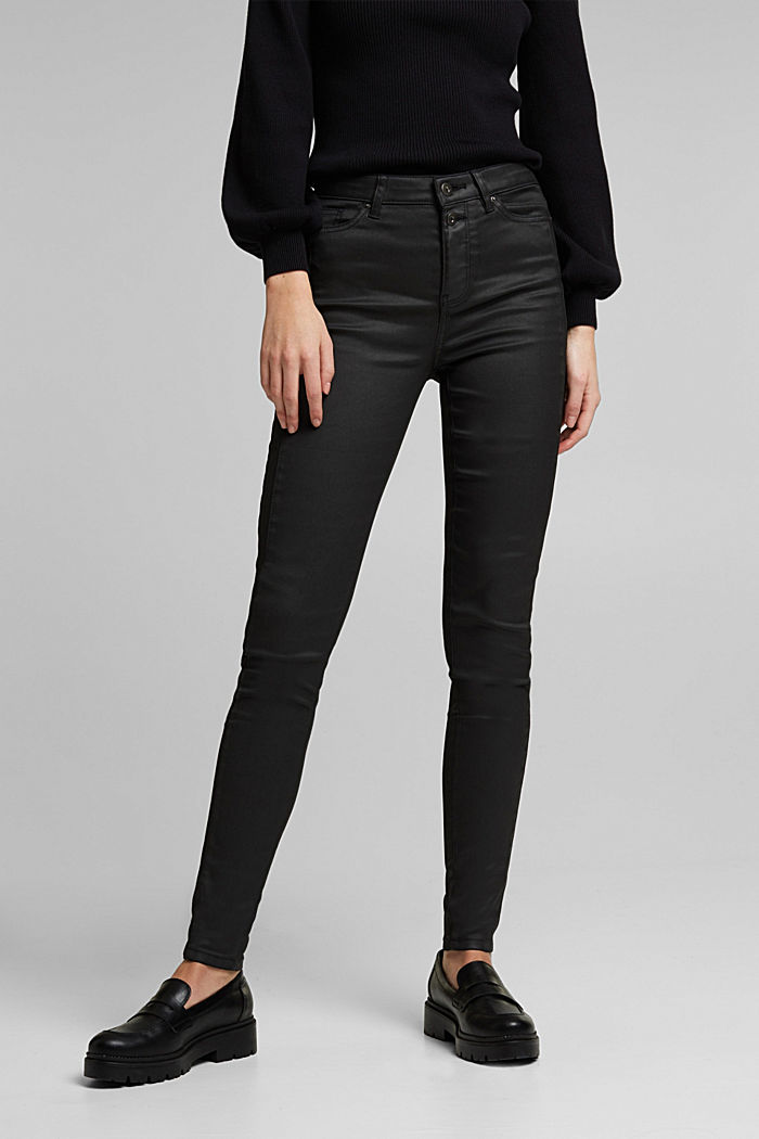 Coated trousers with decorative stitching