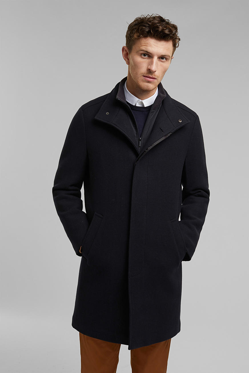 In blended wool: padded coat with a layer detail