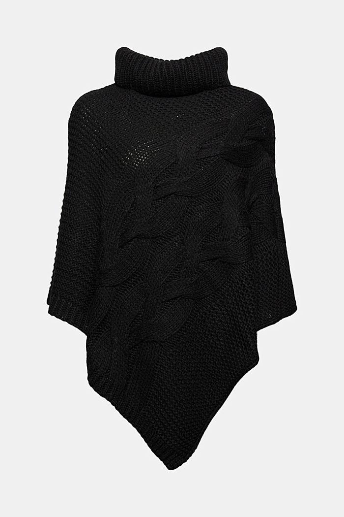 Con lana e alpaca: poncho in maglia a treccia