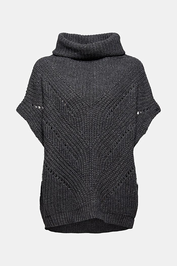 Con lana e alpaca: poncho a maglia con collo dolcevita