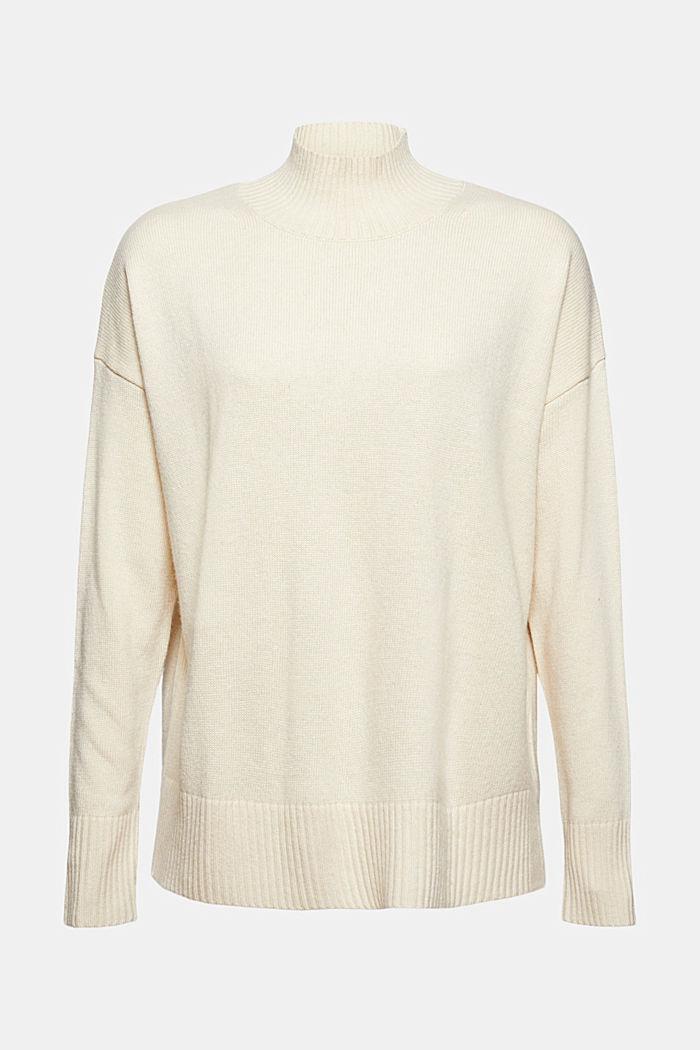 À teneur en laine et en cachemire: le pull-over à col droit