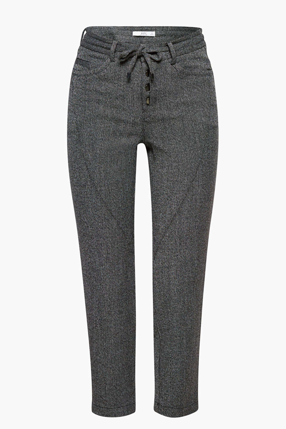 Comfortable and versatile: cropped trousers with a half-visible button placket and a salt and pepper look.