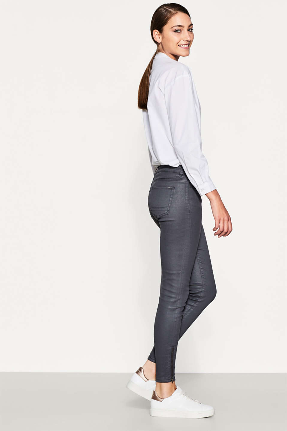 Esprit - Coated stretch trousers with hem zips