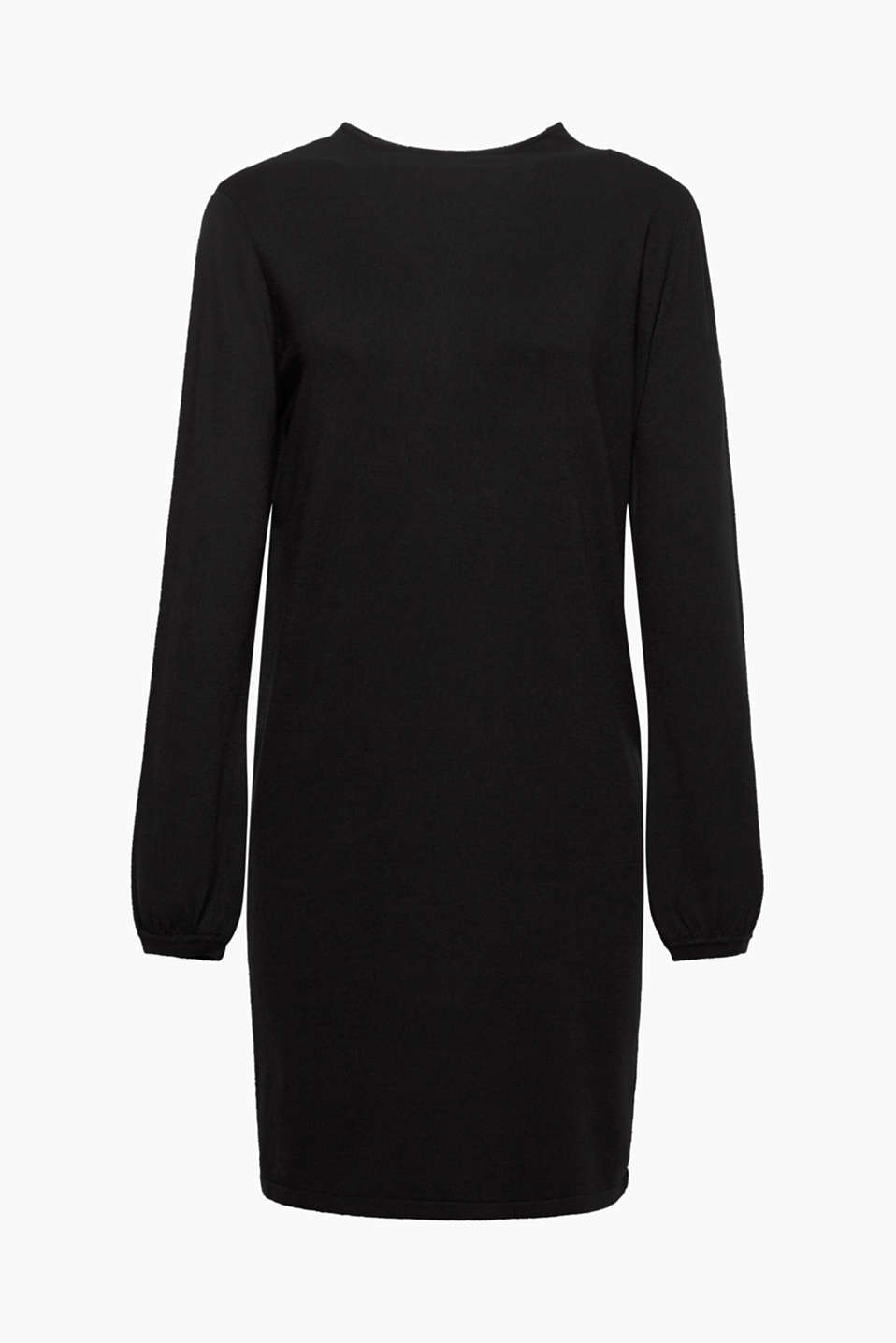The understated styling of this fine-knit dress draws the eye to the trendy balloon sleeves and turtleneck!