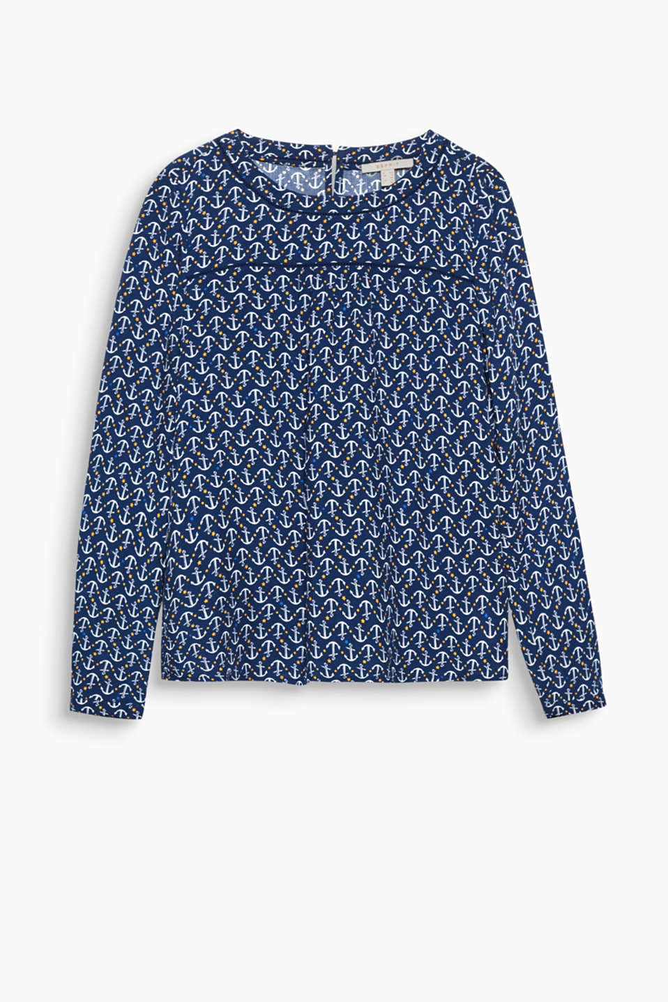 This flowing blouse with an all-over print and openwork pattern is so easy and versatile to wear!