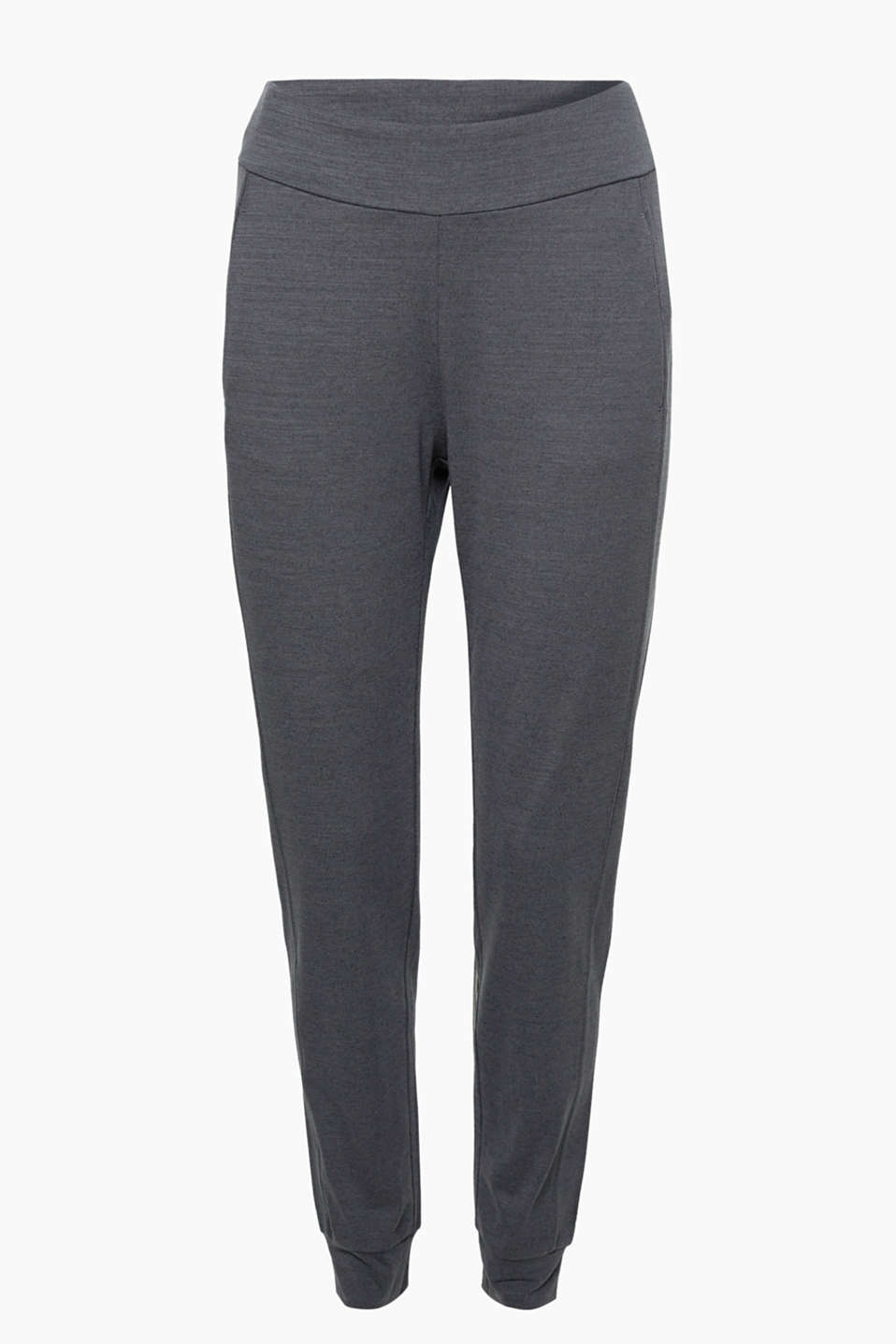 These melange trousers with hem cuffs and slit pockets in a loose, casual, functional style will motivate you to move!