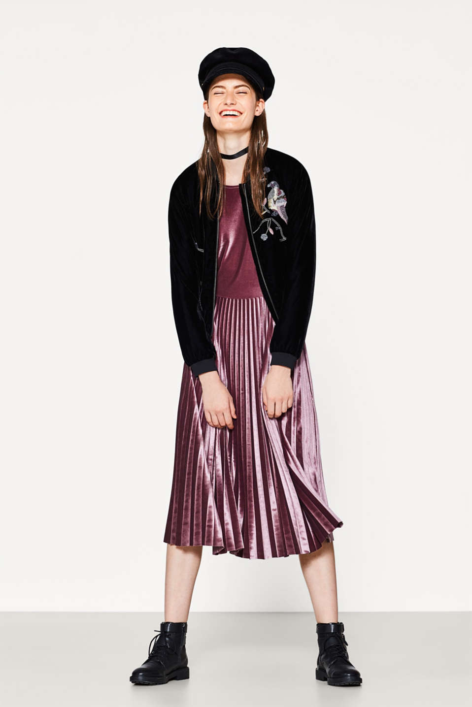 Dress in stretch velvet with a pleated skirt