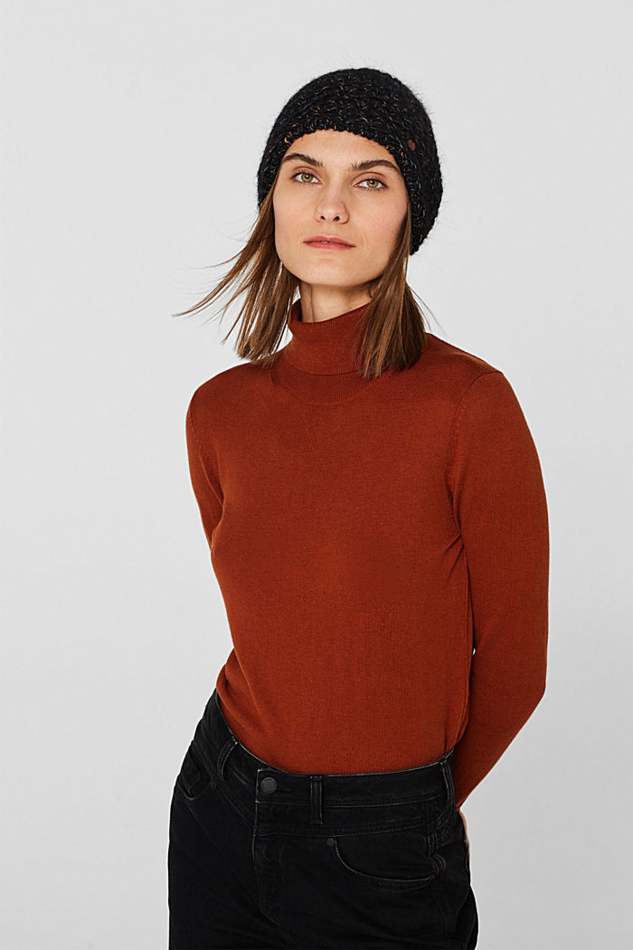 Wool blend: beanie with a faux fur pompom