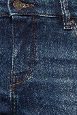 Stretch jeans with decorative piping