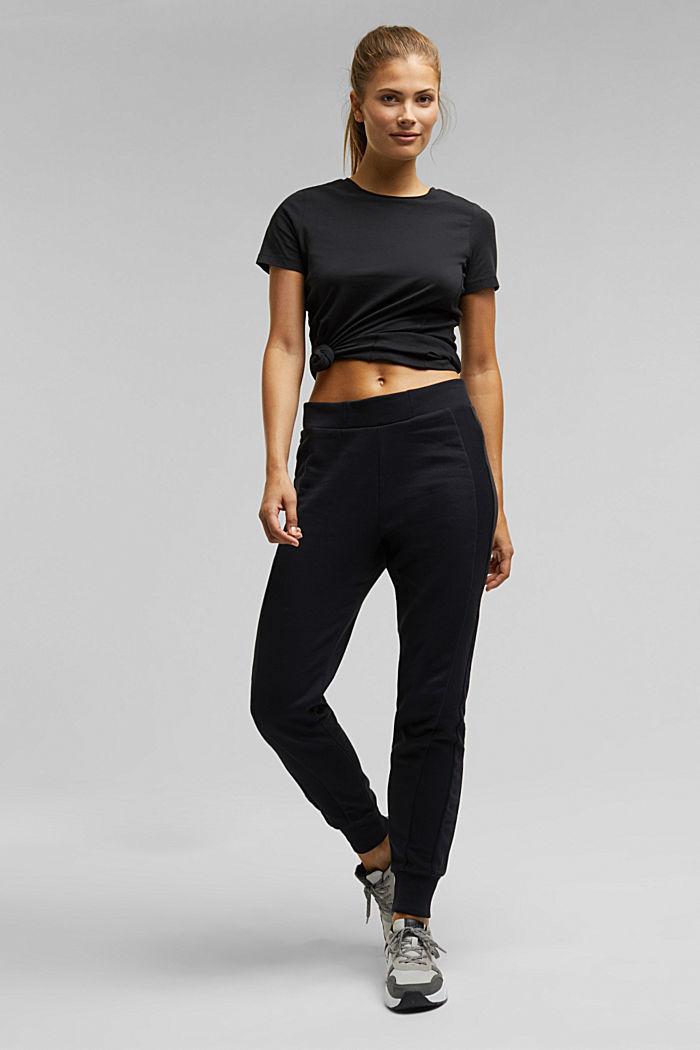 Sweatshirt tracksuit bottoms made of organic cotton, BLACK, detail image number 1